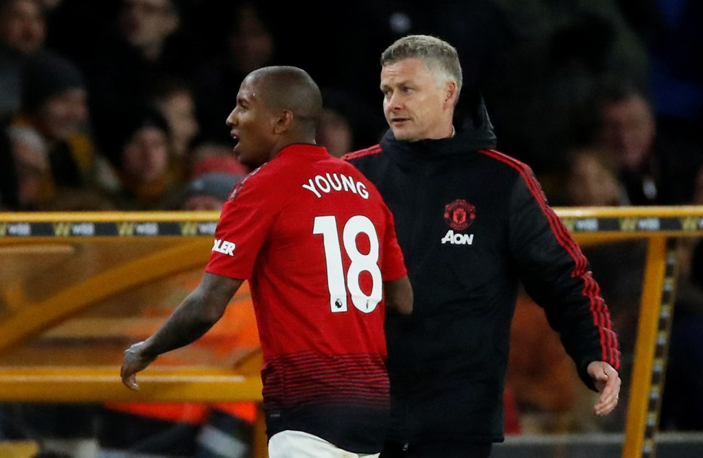 Man Utd's Ashley Young with manager Ole Gunnar Solskjaer after being sent off.