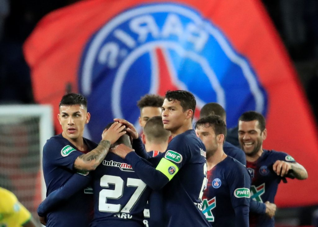 PSG's Thiago Silva and team mates celebrate after the match.
