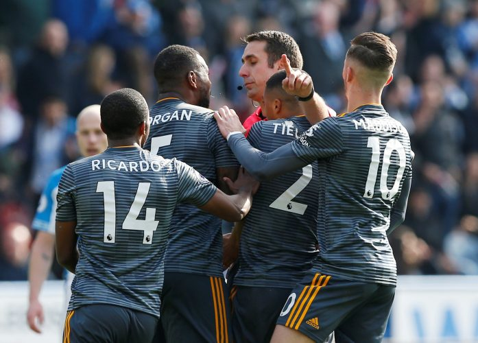 Leicester City's Wes Morgan, Youri Tielemans, James Maddison and Ricardo Pereira remonstrate with referee David Coote as he awards a penalty to Huddersfield.
