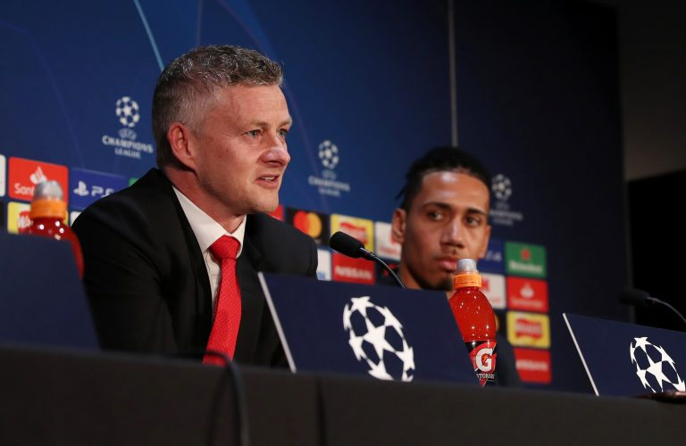 Man Utd manager Ole Gunnar Solskjaer with Chris Smalling during the press conference.