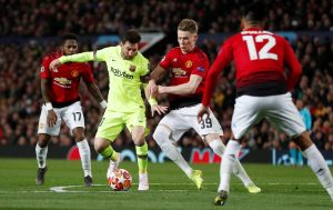Manchester United's Scott McTominay in action with Barcelona's Lionel Messi.