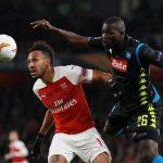 Arsenal's Pierre-Emerick Aubameyang in action with Napoli's Kalidou Koulibaly.