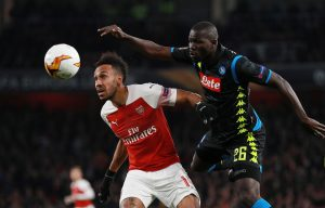 Arsenal's Pierre-Emerick Aubameyang in action with Napoli's Kalidou Koulibaly.
