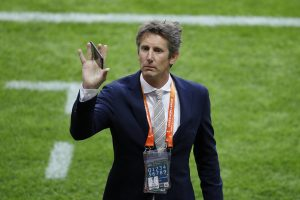 Ajax CEO Edwin van der Sar waves to the fans before the match.