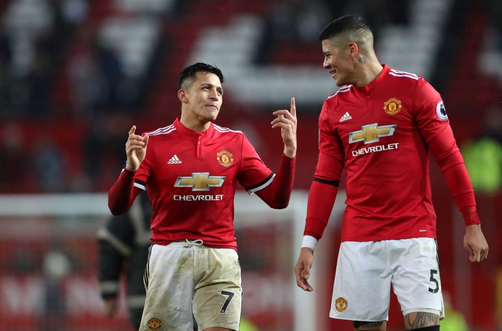 Manchester United's Alexis Sanchez and Marcos Rojo celebrate after the match.