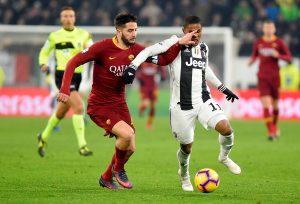 AS Roma's Kostas Manolas in action with Juventus' Douglas Costa.