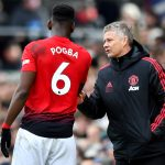 Paul Pogba receives instructions from Ole Gunnar Solskjaer.