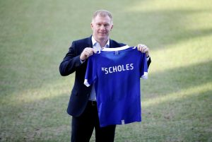 Oldham Athletic manager Paul Scholes poses with a shirt.