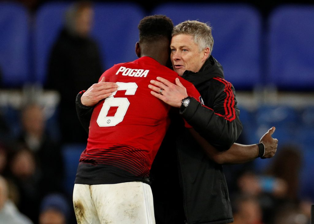 Manchester United manager Ole Gunnar Solskjaer embraces Paul Pogba at the end of the match.