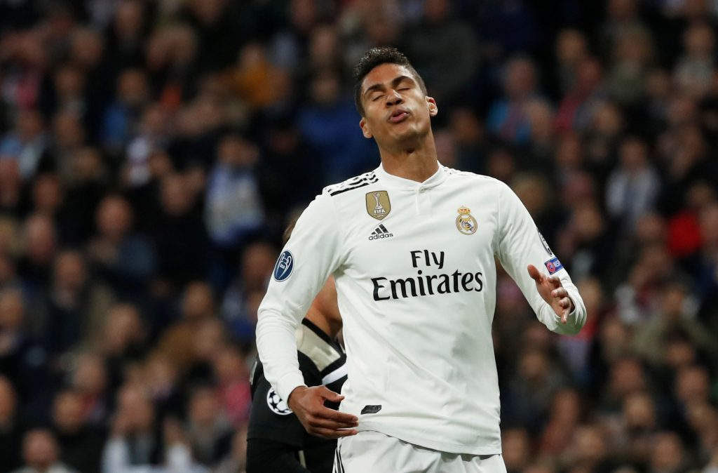 Real Madrid's Raphael Varane reacts.