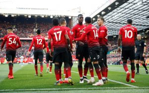 Manchester United's Paul Pogba celebrates scoring their second goal with team mates.