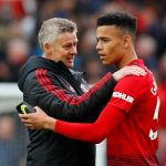 Ole Gunnar Solskjaer and Manchester United's Mason Greenwood celebrate.