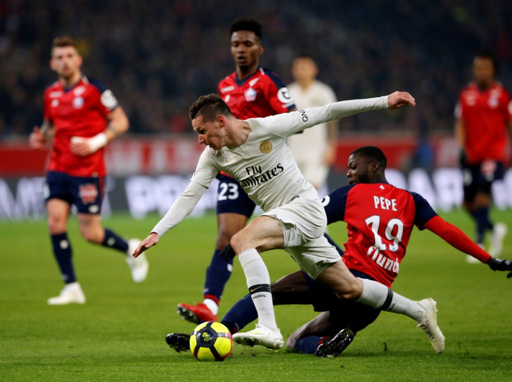 PSG's Julian Draxler in action with Lille's Nicolas Pepe.