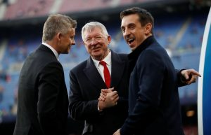 Manchester United manager Ole Gunnar Solskjaer, Sir Alex Ferguson and Gary Neville.