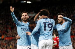 Man City's Leroy Sane celebrates scoring their second goal with Bernardo Silva and team mates.