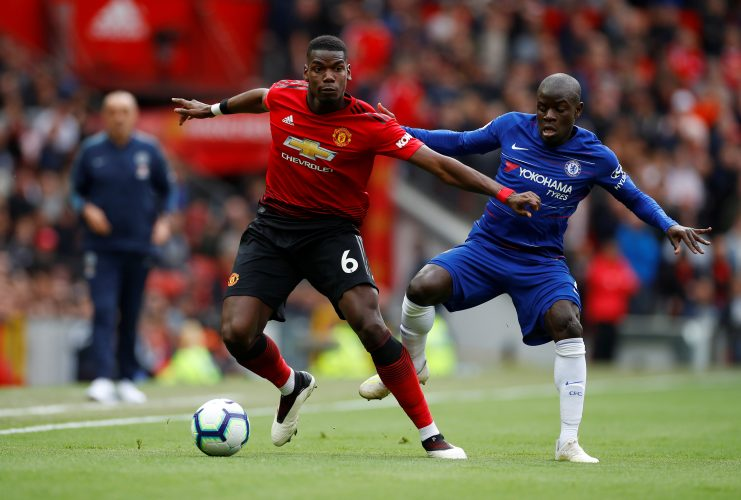 Manchester United's Paul Pogba in action with Chelsea's N'Golo Kante.