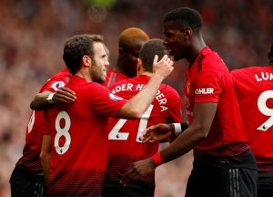 Manchester United's Juan Mata celebrates scoring their first goal with Paul Pogba.