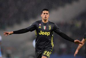 Juventus' Joao Cancelo celebrates scoring their first goal.