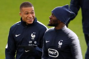 France's Tanguy Ndombele and Kylian Mbappe during training.