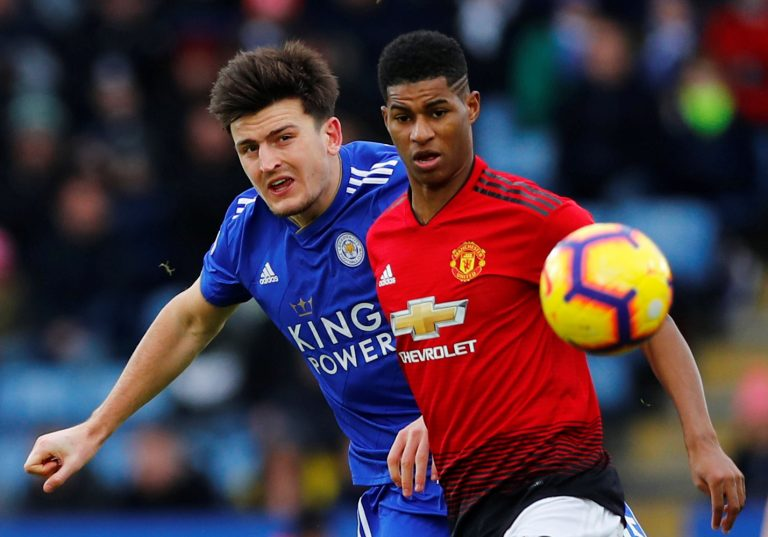 Manchester United's Marcus Rashford in action with Leicester City's Harry Maguire.
