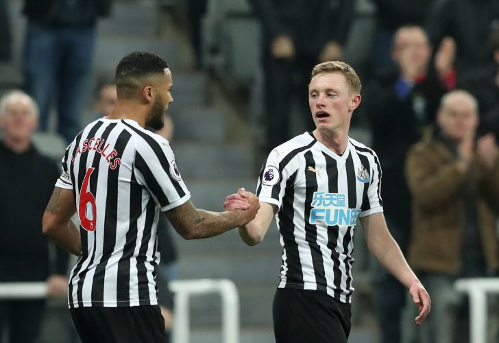Newcastle's Sean Longstaff celebrates scoring their second goal with Jamaal Lascelles.