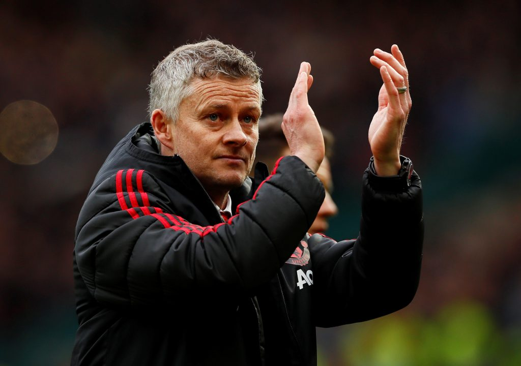 Manchester United manager Ole Gunnar Solskjaer applauds fans after the match.