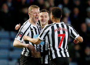 Newcastle's Sean Longstaff celebrates scoring their first goal with Jacob Murphy.