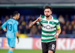 Sporting's Bruno Fernandes celebrates scoring their first goal.