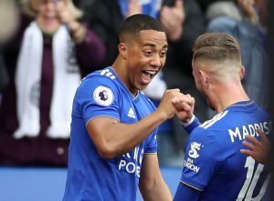 Leicester City's Youri Tielemans celebrates scoring their first goal with James Maddison.