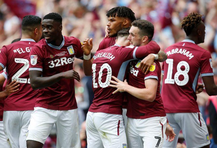 Aston Villa's John McGinn celebrates scoring their second goal with Jack Grealish and team mates.