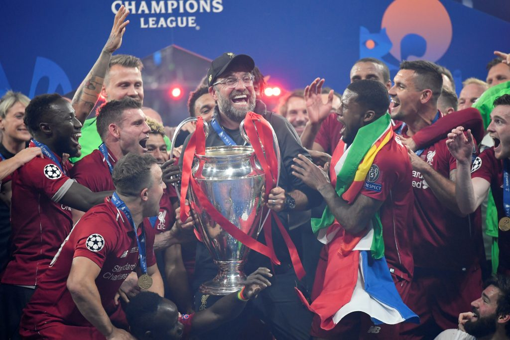 Liverpool manager Jurgen Klopp lifts the trophy as they celebrate after winning the Champions League.