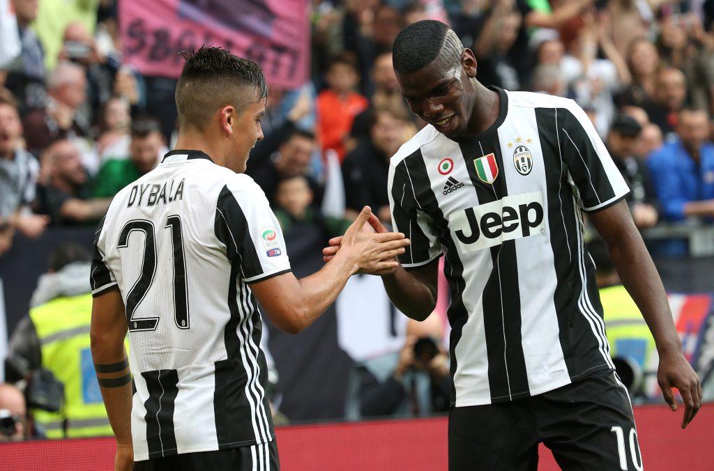 Juventus' Paulo Dybala celebrates with teammate Paul Pogba.