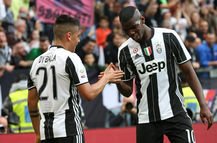 Juventus' Paulo Dybala celebrates with teammate Paul Pogba.