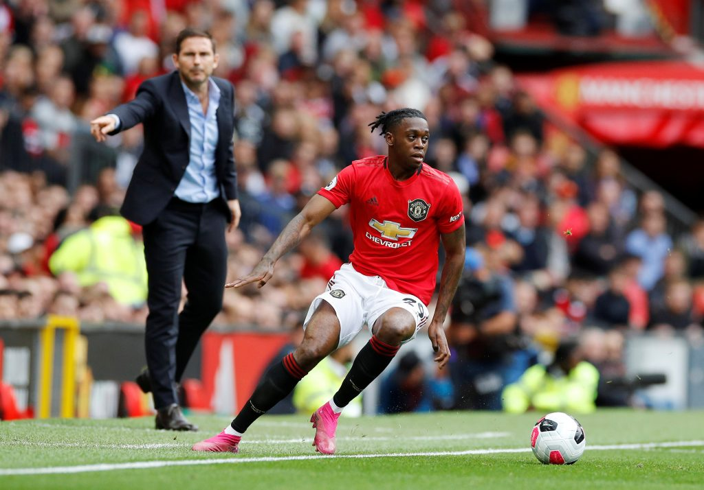 "Soccer Football - Premier League - Manchester United v Chelsea - Old Trafford, Manchester, Britain - August 11, 2019  Manchester United's Aaron Wan-Bissaka in action as Chelsea manager Frank Lampard gestures  REUTERS/Phil Noble  EDITORIAL USE ONLY. No use with unauthorized audio, video, data, fixture lists, club/league logos or ""live"" services. Online in-match use limited to 75 images, no video emulation. No use in betting, games or single club/league/player publications.  Please contact your account representative for further details. - RC1FA9B1FA20"