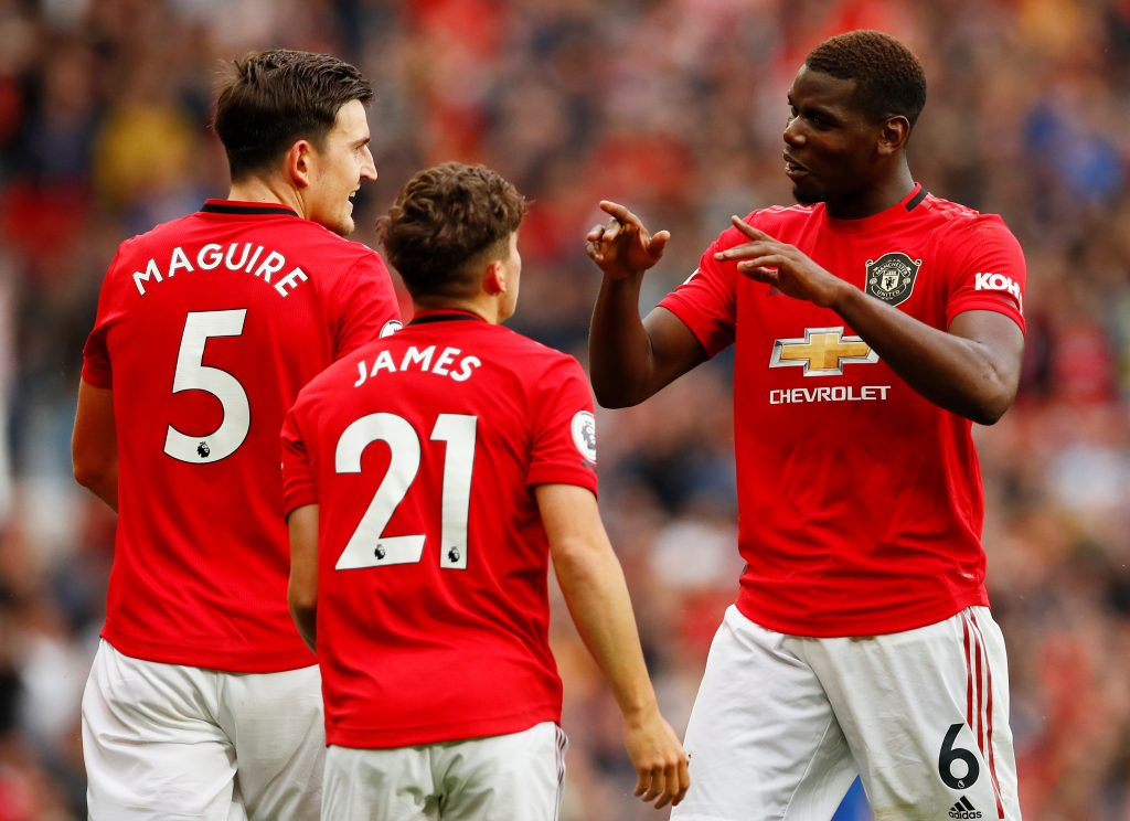 """Soccer Football - Premier League - Manchester United v Chelsea - Old Trafford, Manchester, Britain - August 11, 2019  Manchester United's Daniel James celebrates scoring their fourth goal with Harry Maguire and Paul Pogba   Action Images via Reuters/Jason Cairnduff  EDITORIAL USE ONLY. No use with unauthorized audio, video, data, fixture lists, club/league logos or """"live"""" services. Online in-match use limited to 75 images, no video emulation. No use in betting, games or single club/league/player publications.  Please contact your account representative for further details. - RC1A9C722C00"""