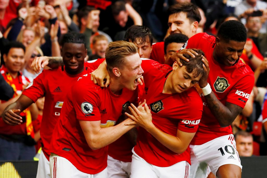 Daniel James celebrates scoring club's fourth goal with Scott McTominay, Marcus Rashford and team mates.