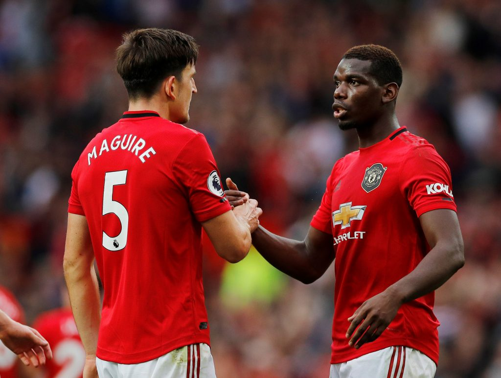 Manchester United's Harry Maguire and Paul Pogba celebrate at the end of the match.