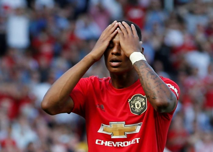 Manchester United's Marcus Rashford reacts after missing a penalty.