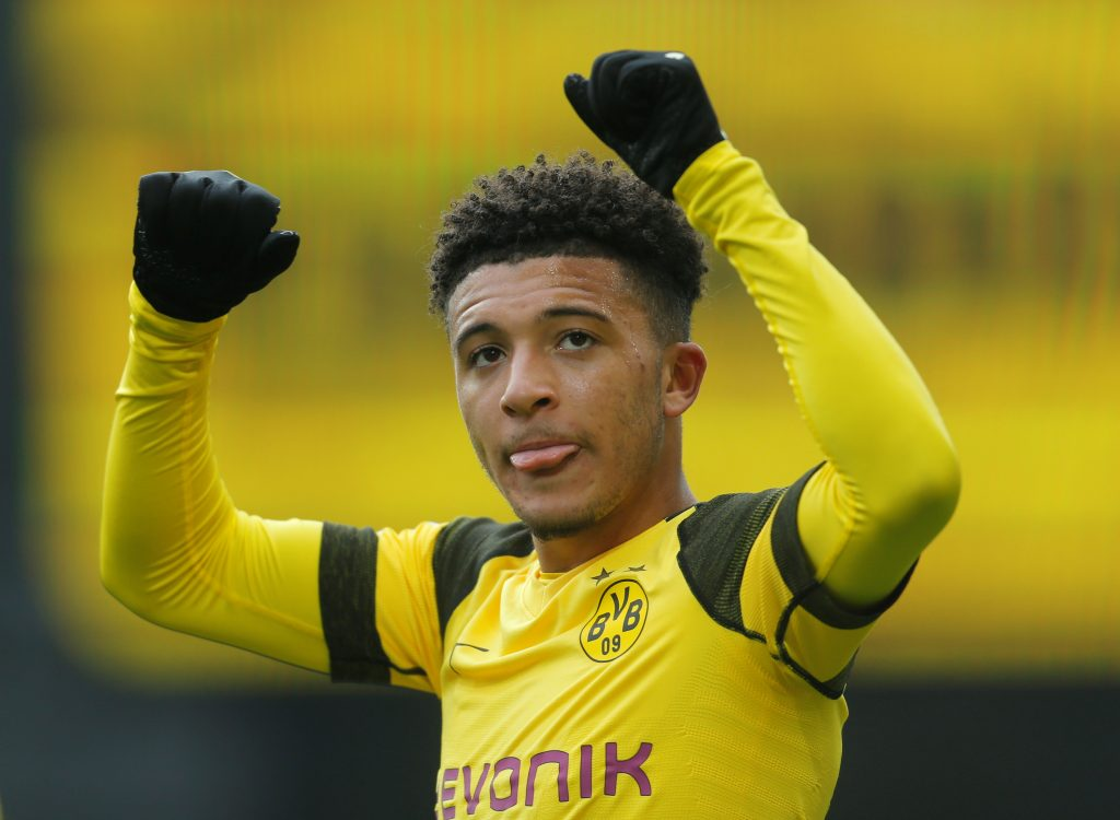 Borussia Dortmund's Jadon Sancho celebrates scoring their first goal.