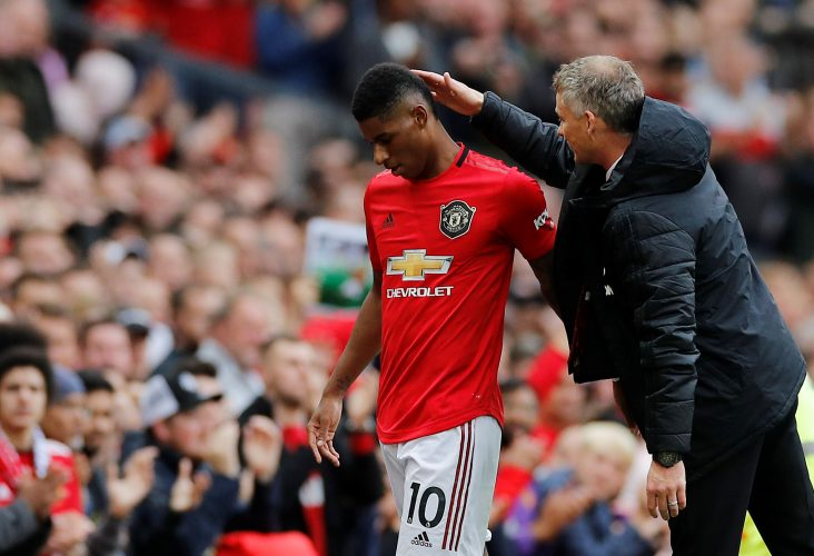 Manchester United's Marcus Rashford is congratulated by manager Ole Gunnar Solskjaer as he is substituted.