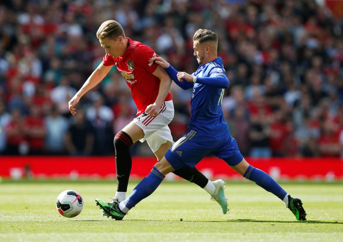Manchester United's Scott McTominay in action with Leicester City's James Maddison.