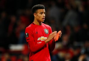 Manchester United's Mason Greenwood applauds the fans after the match.