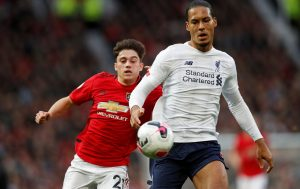 Liverpool's Virgil van Dijk in action with Manchester United's Daniel James.