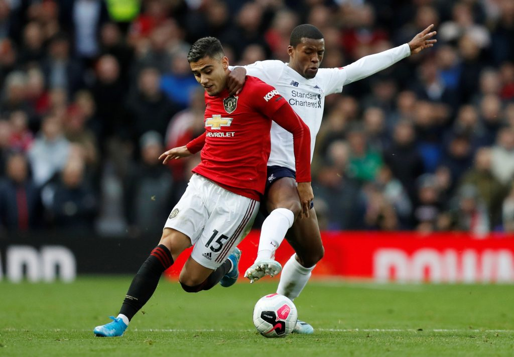 Manchester United's Andreas Pereira in action with Liverpool's Georginio Wijnaldum.