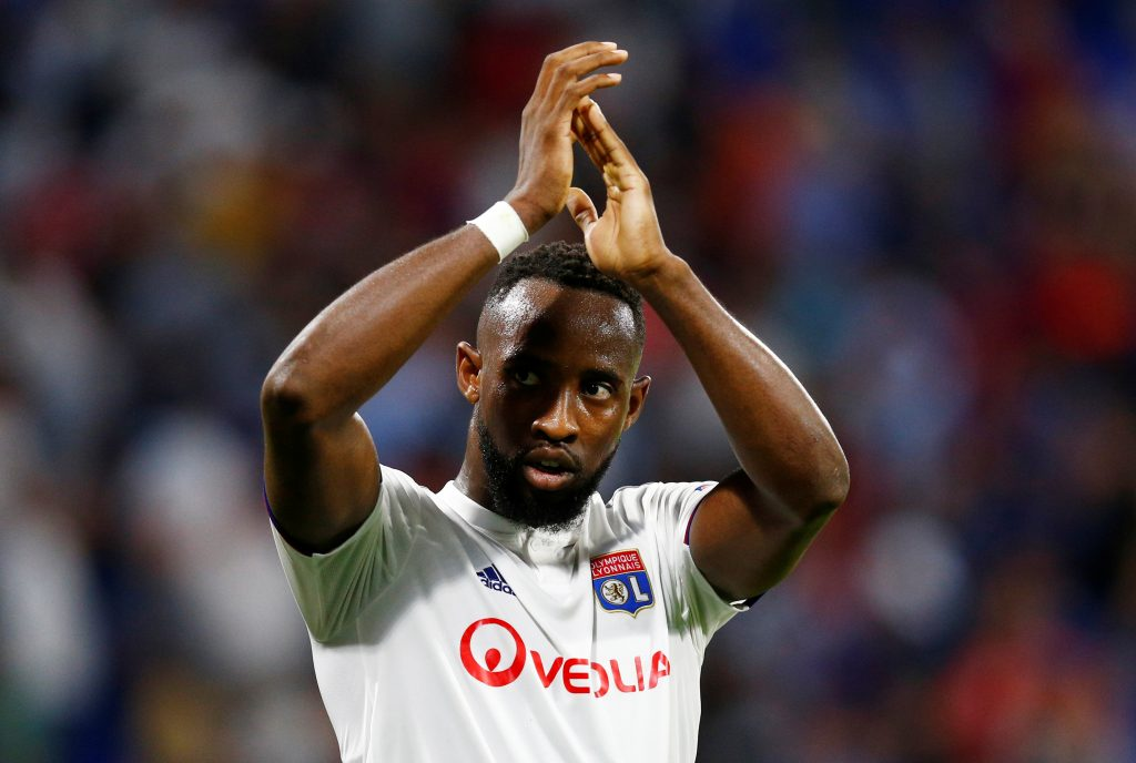 Lyon's Moussa Dembele applauds fans after the match.