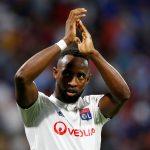 Lyon's Moussa Dembele applauds fans after the match.