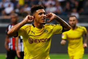 Borussia Dortmund's Jadon Sancho celebrates scoring their second goal.
