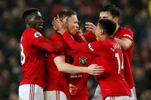Manchester United's Scott McTominay celebrates scoring their first goal with team mates.
