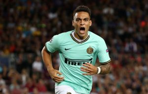 Inter Milan's Lautaro Martinez celebrates scoring their first goal.