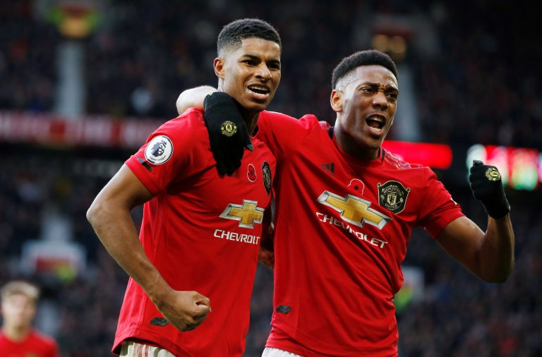 Manchester United's Marcus Rashford celebrates scoring their third goal with Anthony Martial.